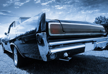 Tail end of classic car in blue color tone