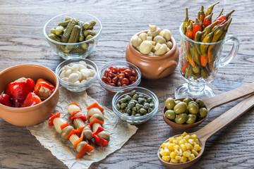 Pickled vegetables on the wooden background
