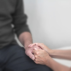 Offering comfort to a male patient