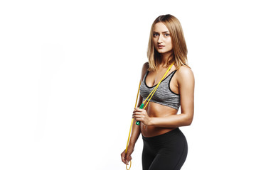 pretty fitness girl stay with jumping rope