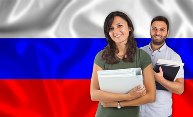 Couple of students over russian flag