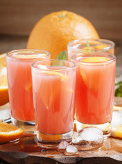 Freshly squeezed juice from red orange, selective focus