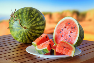 Ripe watermelon on a wooden table