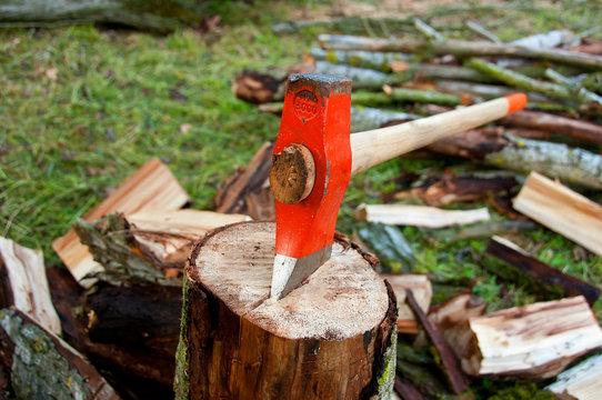 Axe on a wood log