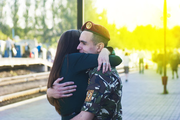 girl meets a soldier at the station in Ukraine