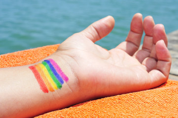 man with the rainbow flag painted in his wrist