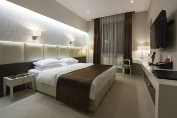 Hotel bedroom interior in the evening