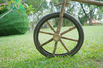 bamboo bicycle wheel spokes on green grass
