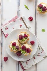 Sweet tartalette with fresh raspberries