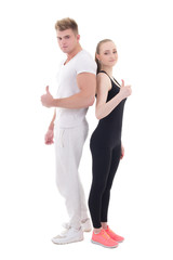 young man and woman in sportswear thumbs up isolated on white