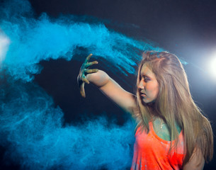 girl with colored powder exploding around her and into the background