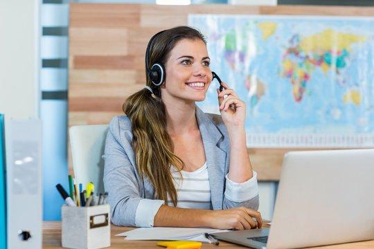Pretty travel agent speaking to customer