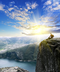 man sitting on top of Norway mountain. Conceptual design