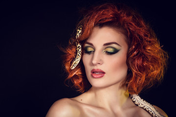 Portrait of Beautiful Woman in studio with dangerous snake