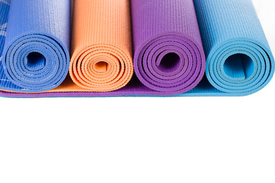 Colorful yoga mat and on white background