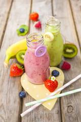Fresh blended fruit smoothies in vintage milk bottles