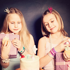 Young Girls Friends with Gift Box and Cake. Birthday Concept