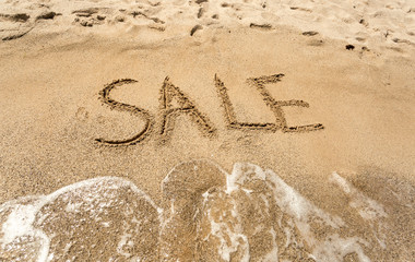 Conceptual photo of Sale written on sandy beach