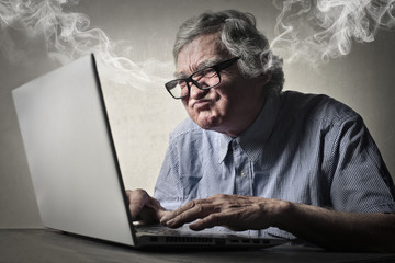 Angry businessman working at pc