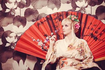 young pretty geisha in kimono with sakura and decoration Wall mural