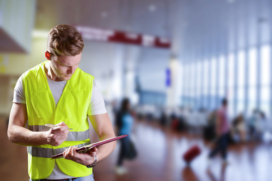 young male working  in airport