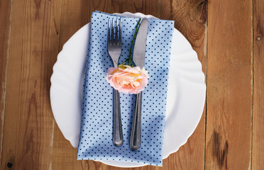 table setting with napkins and rose