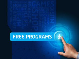 Free programs. Businessman presses a button on the virtual scree