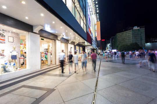 Modern shopping street and people in urban city