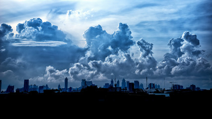 Self adhesive Wall Murals Heaven Dark blue storm clouds over city in rainy season