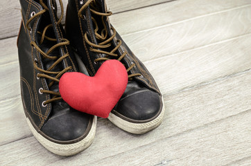 Shoes and red heart. Love theme
