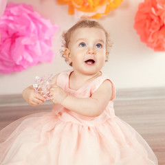 cute baby girl celebrates birthday one year.
