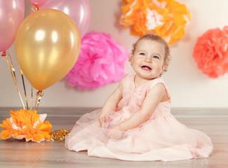 cute baby girl celebrates birthday one year.