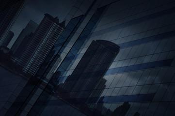 Fototapete - Reflect of modern city and dark strom sky on window glass tower