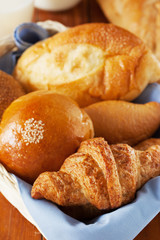 croissant ,bun and bread in basket for breakfast