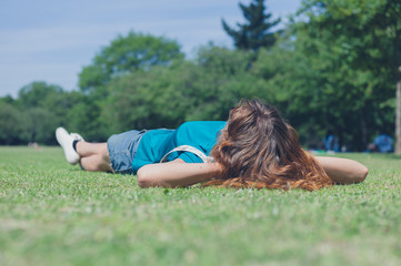 Young woman lying on grass in the park
