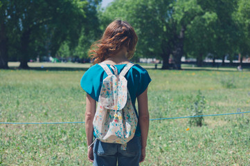 Young woman looking at meadow