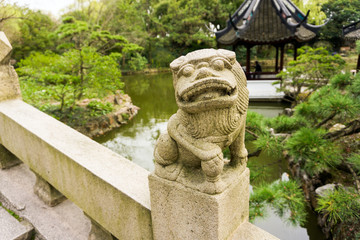 Chinese Lion on Bridge in Classical Garden