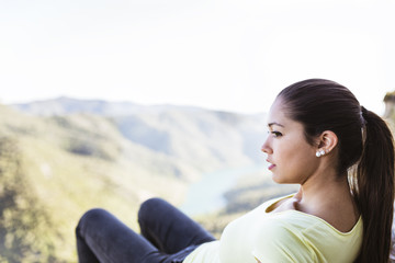 young woman on top of a mountain with good views