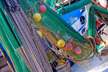 Fishing net with colorful elements / a fishing net full of colorful floats