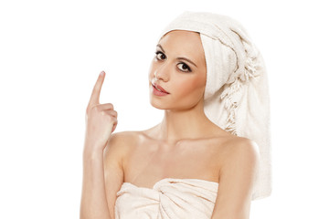 woman with a towel on her head advertises imaginary product