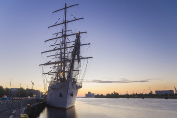 great sailing ship moored at the wharf