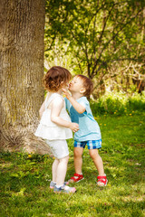 two children kids hugging kissing