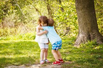two children kids hugging kissing