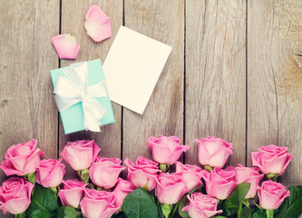 Valentines day greeting card, gift box and pink roses