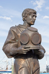 Bronze Sponge Diver Upper - Sculpture of Bronze Sponge Diver Dressed in His Diving Suite and Holding His Metal Diving Helmet