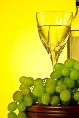glass of white wine and grape