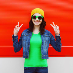 Fashion portrait of stylish cool girl in sunglasses and colorful