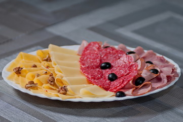 slices  cheese of sausage  black olives
