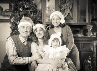 antique photo of happy family celebrating Christmas