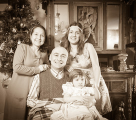 happy  family of three generations at Christmas time